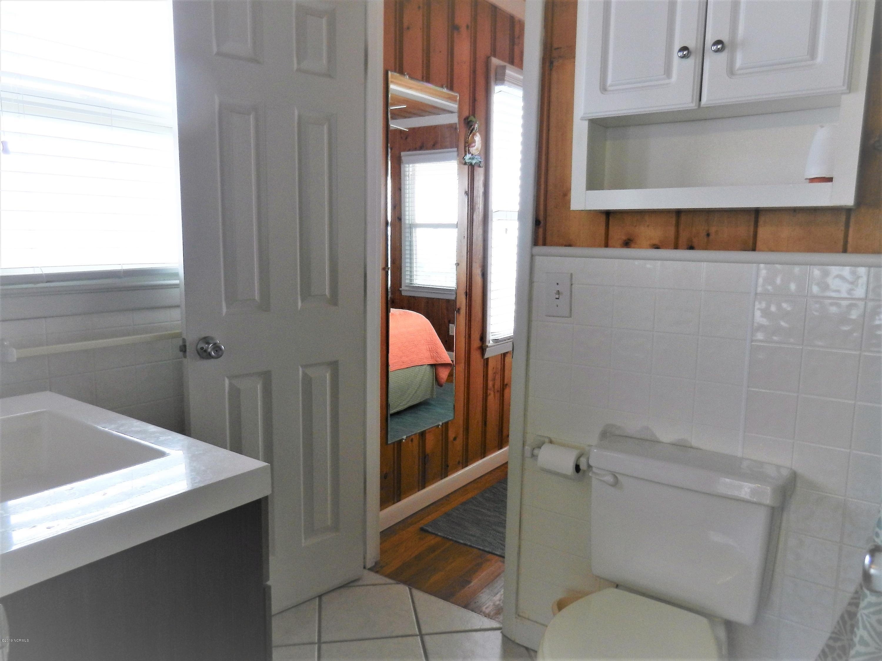 401 First Street, Ocean Isle Beach, North Carolina 28469, 4 Bedrooms Bedrooms, 8 Rooms Rooms,2 BathroomsBathrooms,Single family residence,For sale,First,100174652