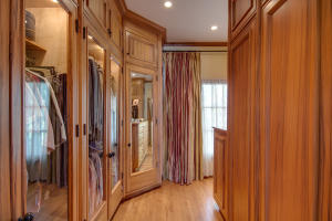 Custom gumwood walk in closet.