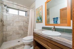 Tiled and heated bathroom.