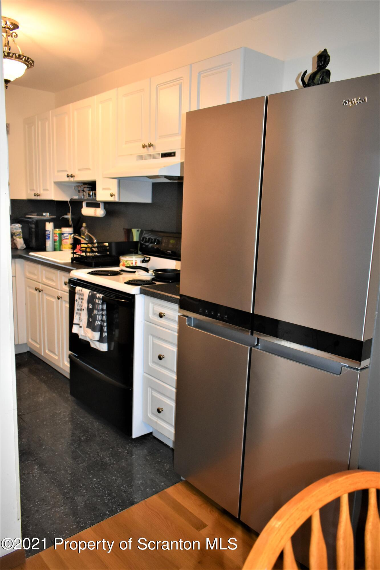 KITCHEN WITH RECENTLY PURCHASED REFRIGER