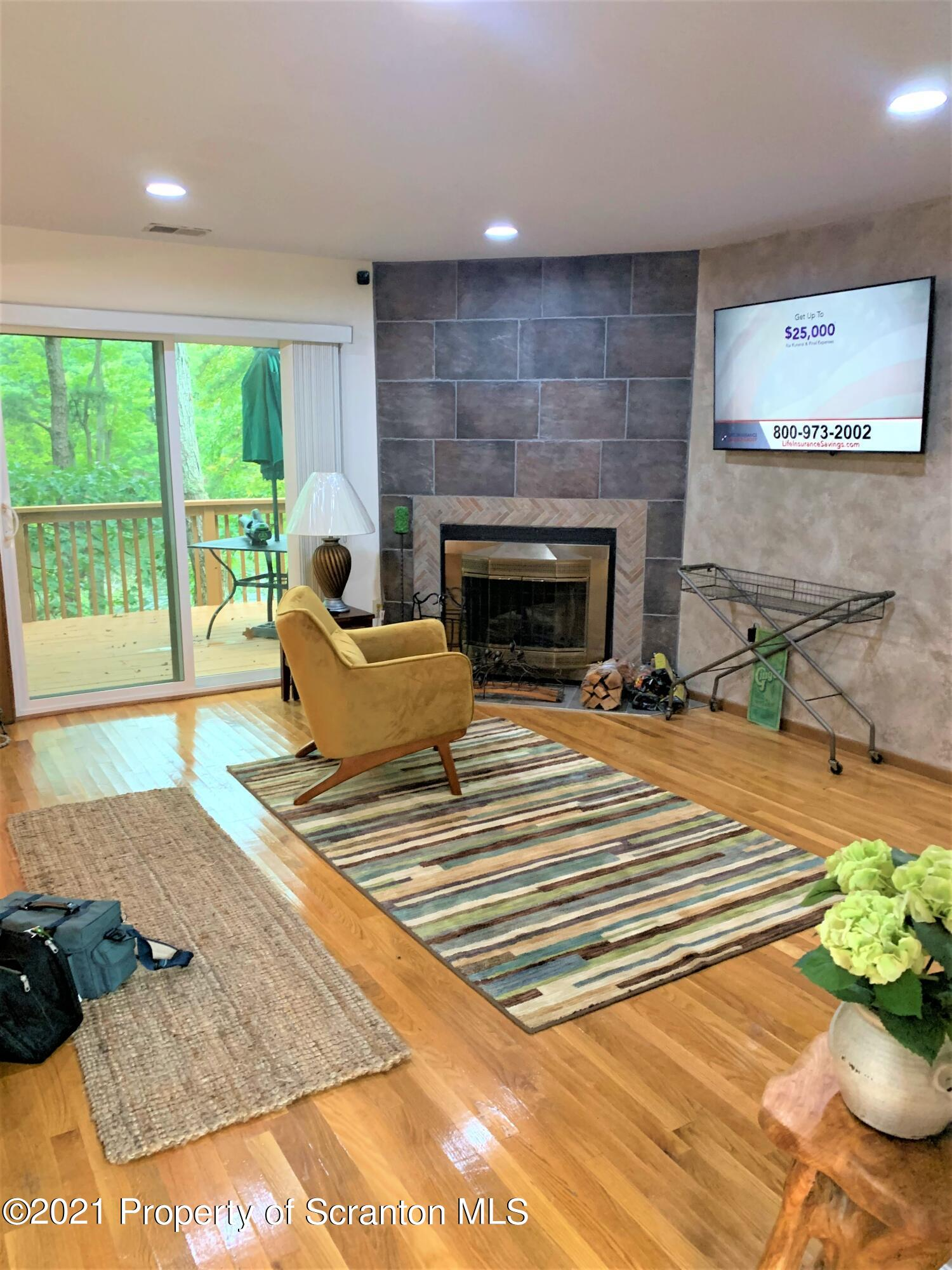 LIVING ROOM AND WOOD FIREPLACE