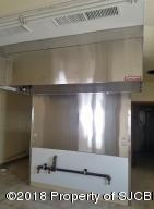 Newer stove hood in kitchen