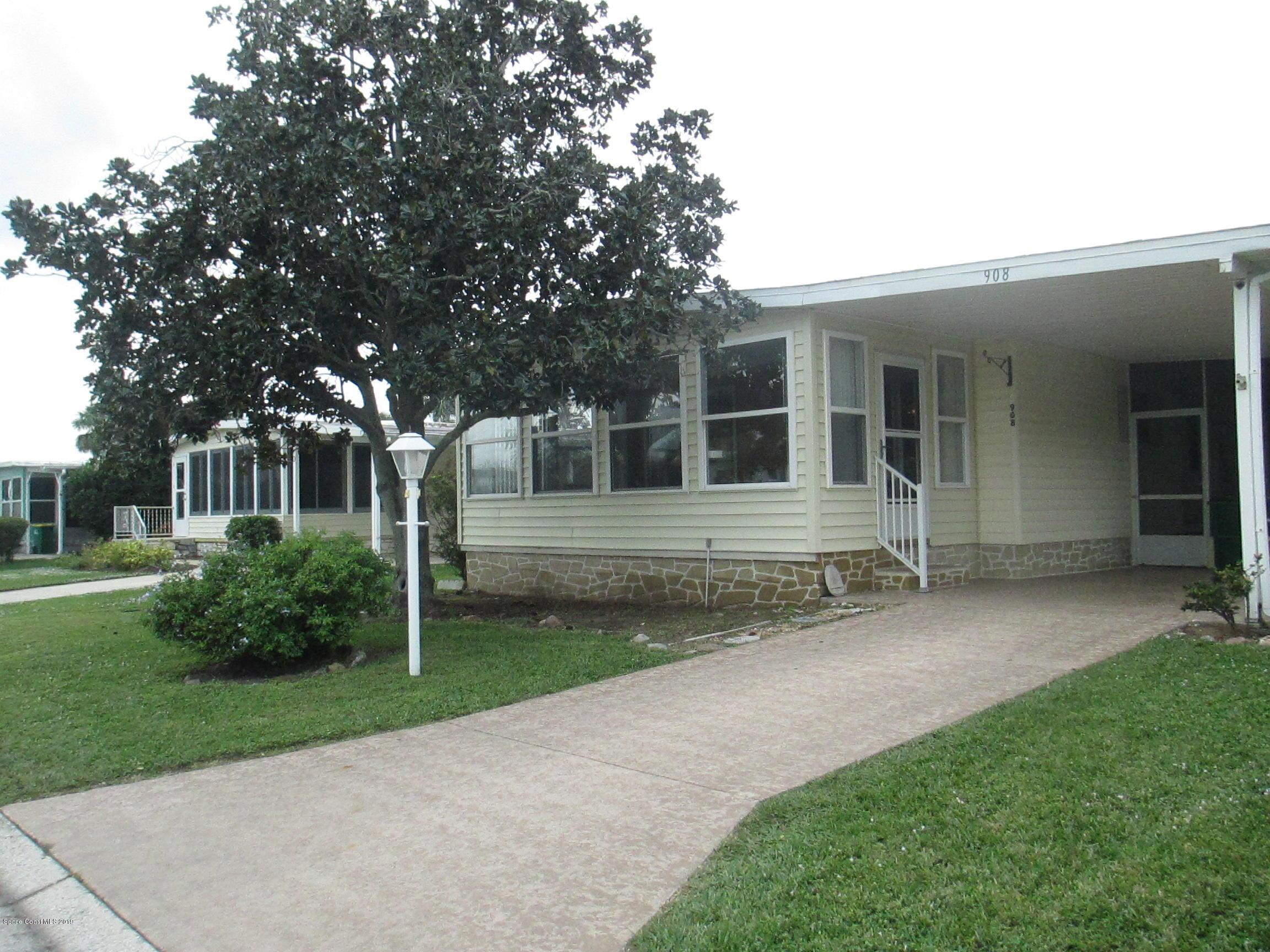 Photo of 908 Wren Circle, Barefoot Bay, FL 32976
