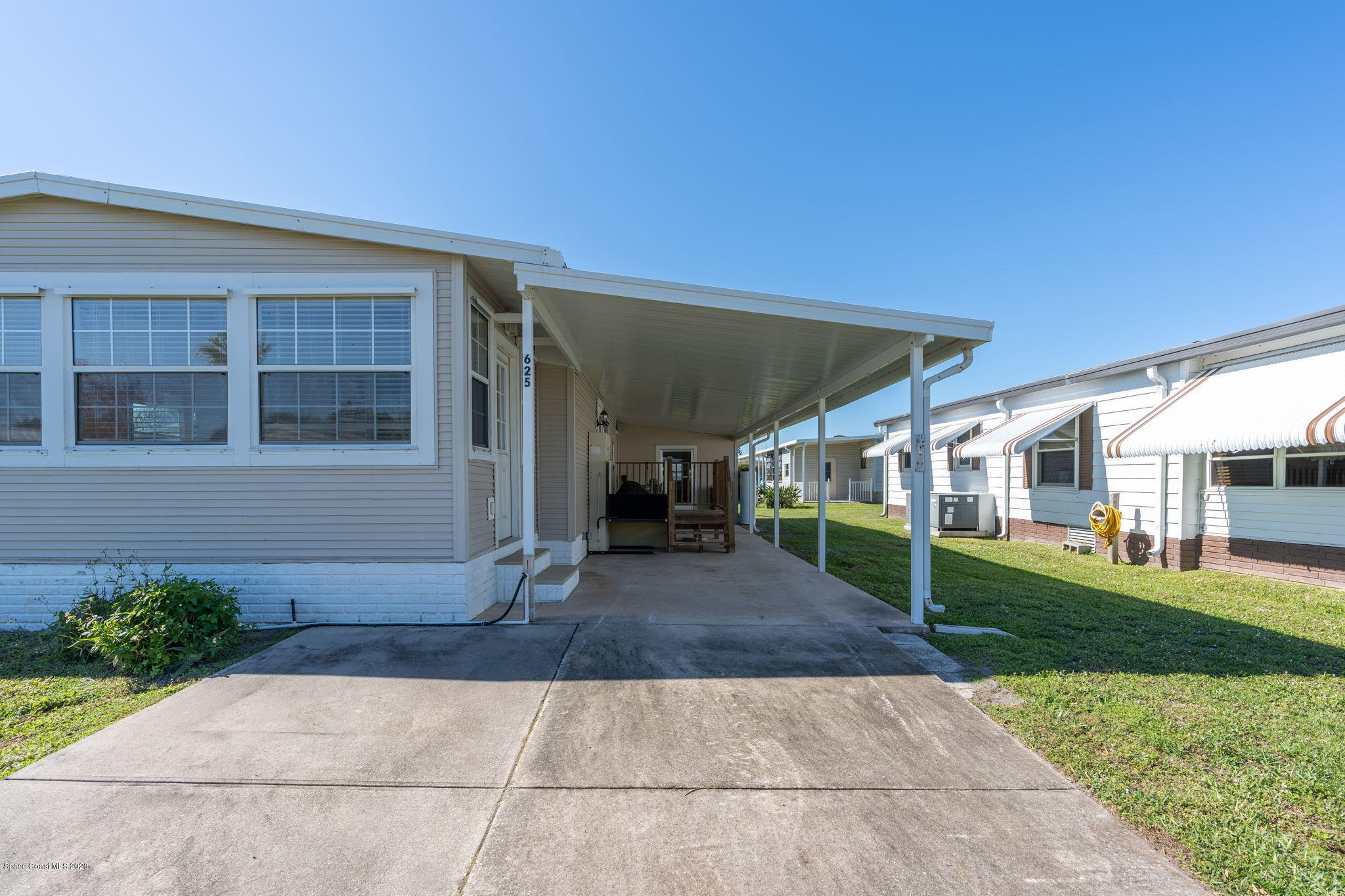 Photo of 625 Hyacinth Circle, Barefoot Bay, FL 32976