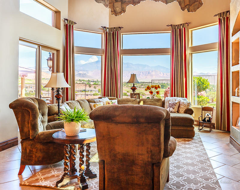 This beautiful custom home sits high above St. George offering panoramic mountain and city views.  Awake to breathtaking sunrises and be awed by the beauty of the red rocks as the sun slowly sets.  The kitchen and pool area provide the perfect setting for entertaining guests or a quiet romantic evening.  This 2006 parade  home boasts a large master suite, private office, workout area, craft room,