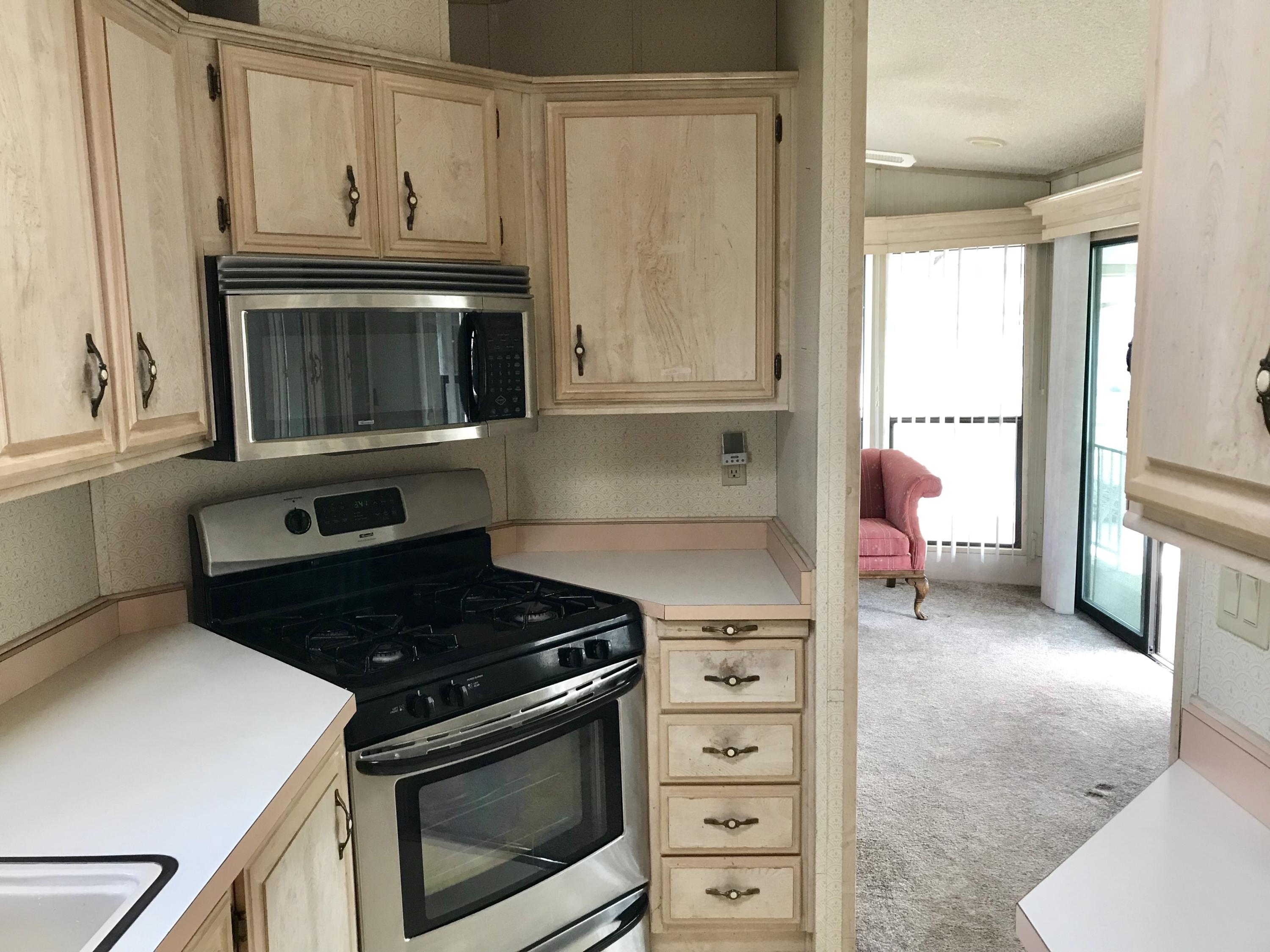 This park model has great potential! It has newer appliances (refrigerator, dishwasher, stove, microwave). The home has new carpet, study deck, and tons of white storage cabinets. The home is being sold in as-is condition.