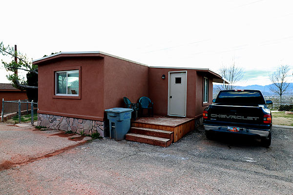 Incredible 2 bedrooms/2 bathrooms, 3 patios. HUD approved mobile home on 0.27 acre horse property lot.  No HOA!! Has fantastic view over the Sunset area of St. George.  Has built in classy closets, double sinks in all bathrooms, granite counter tops in all bathrooms.  Home was completely redone less than 2 years ago.  Has hurricane tie-down installed.  Enjoy the grape vines & pomegranate tree.