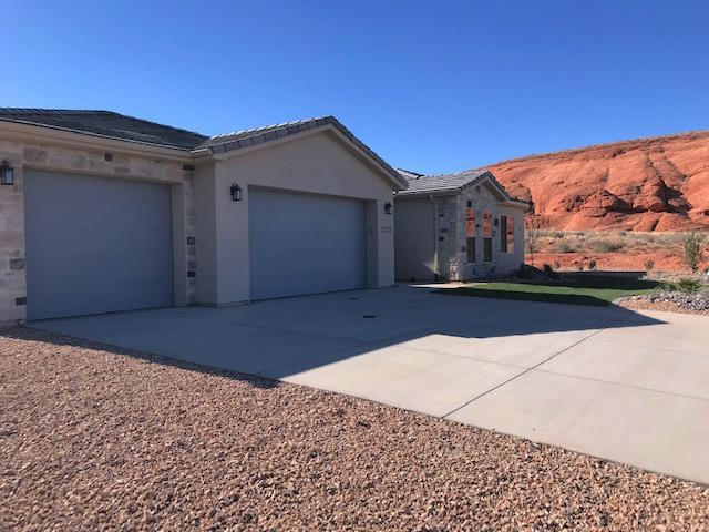 Single Level living!!- Beautifully built new home surrounded by the beauty of Southern Utah red rocks and grand mountains... only 20 min from St George and 20 to Zions National Park!! Open floor plan with lots of natural light. Granite counters, stainless steel appliances. Beautiful surrounding areas with red rocks and only minutes from Sand Hollow State park and Sand Hollow Golf course.