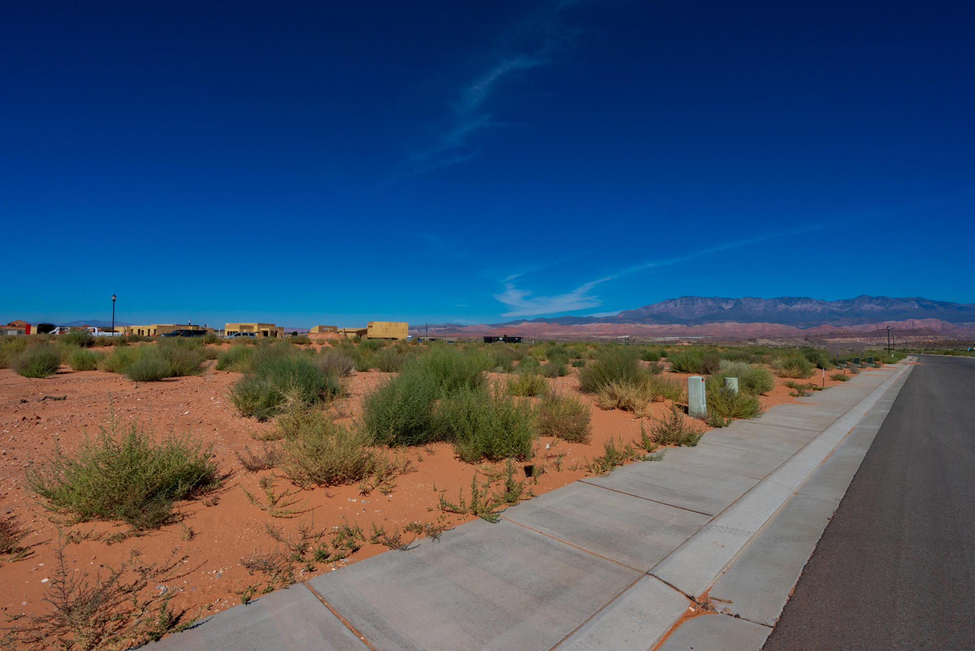 Beautifully located lot with a view of Pine Valley Mtn. as well as the Red Hills and cliffs, sunsets in the back yard.  Perfect to bring an approved builder or work with Sand Hollow Resort\
