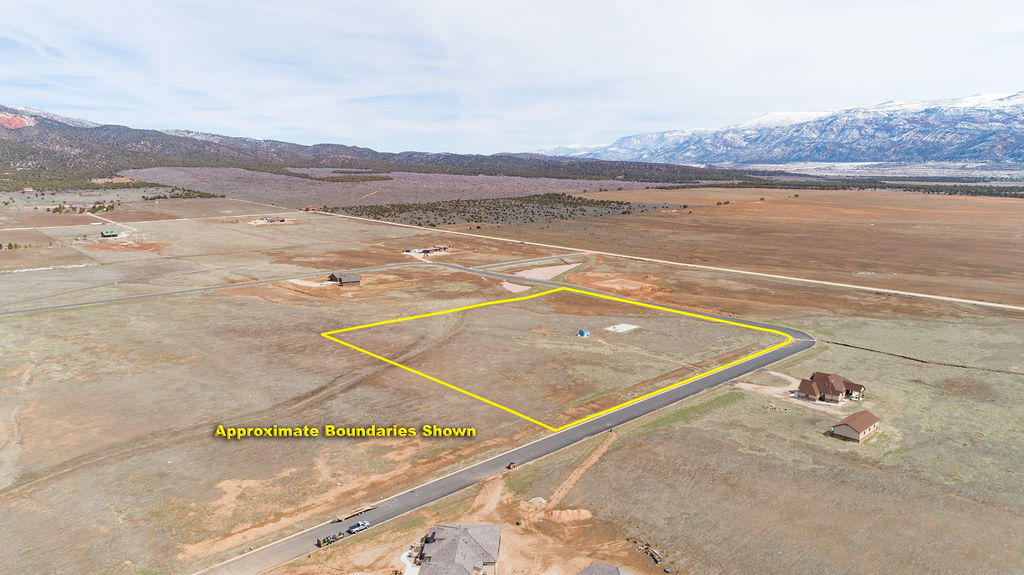 One of the best lots in New Harmony. Beautiful views, corner lot, paved road, curb and gutter, water on the property. There is no irrigation water to the property. There is 1 acre foot of culinary water. Buyer to verify water and water rights. Cable, natural gas, telephone, and electricity are to the edge of the lot. The 12x18 Storage shed is built to last and has an attic space.