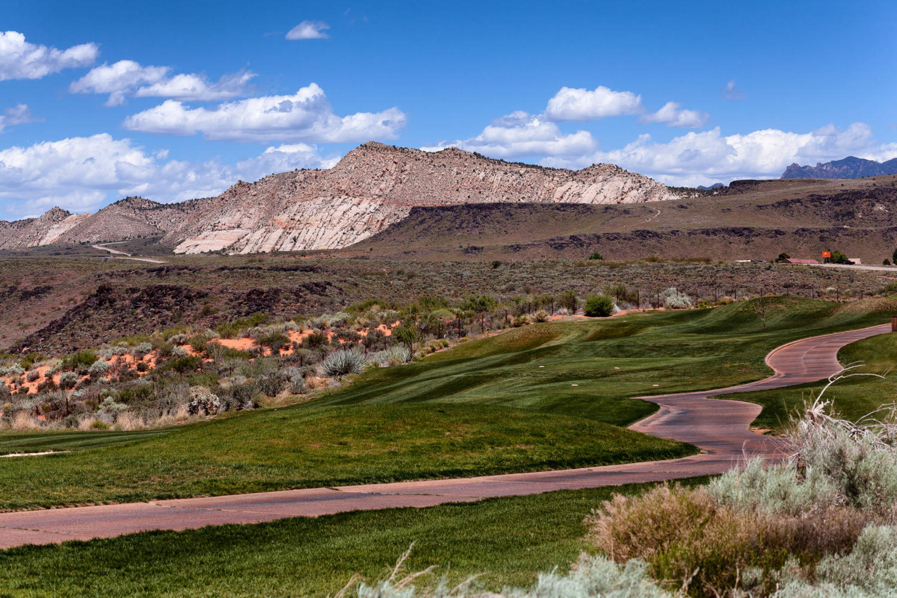 A rare .64 acre Rim and Golf Course lot. Majestic views of the red mountains of Snow Canyon and of Pine mountain. Situated along The Ledges Golf Course signature #12th. green.  Words can not describe the panoramic views from this once in a life time dream home property. Please call listing agent for more information or details.