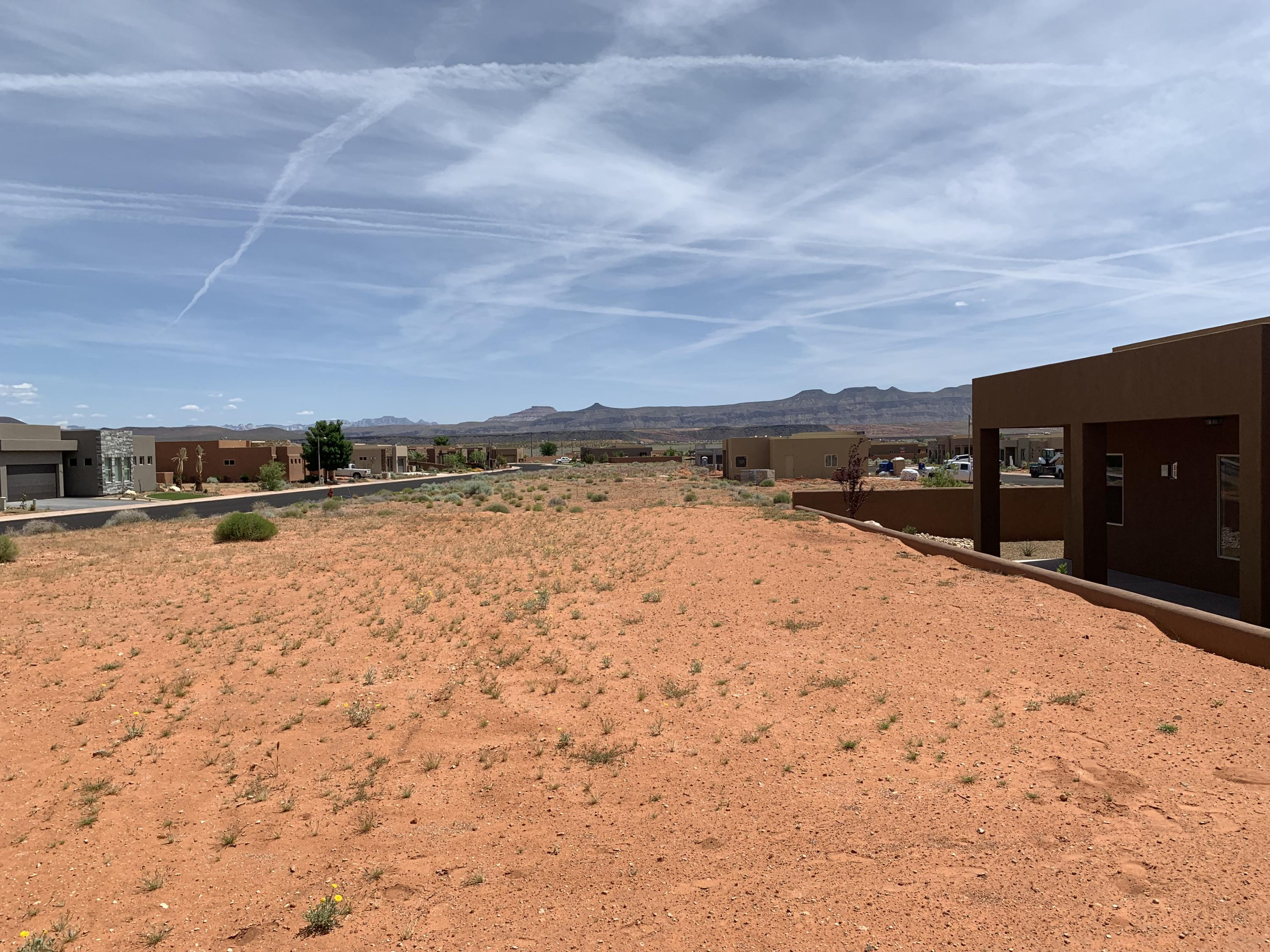 Water fee is PAID on this beautiful elevated homesite. Saving the new owner nearly $10k!The Dunes at Sand Hollow Resort offers two community pools and discount golf at the amazing Sand Hollow Golf Club.  Located in the heart of Southern Utah\