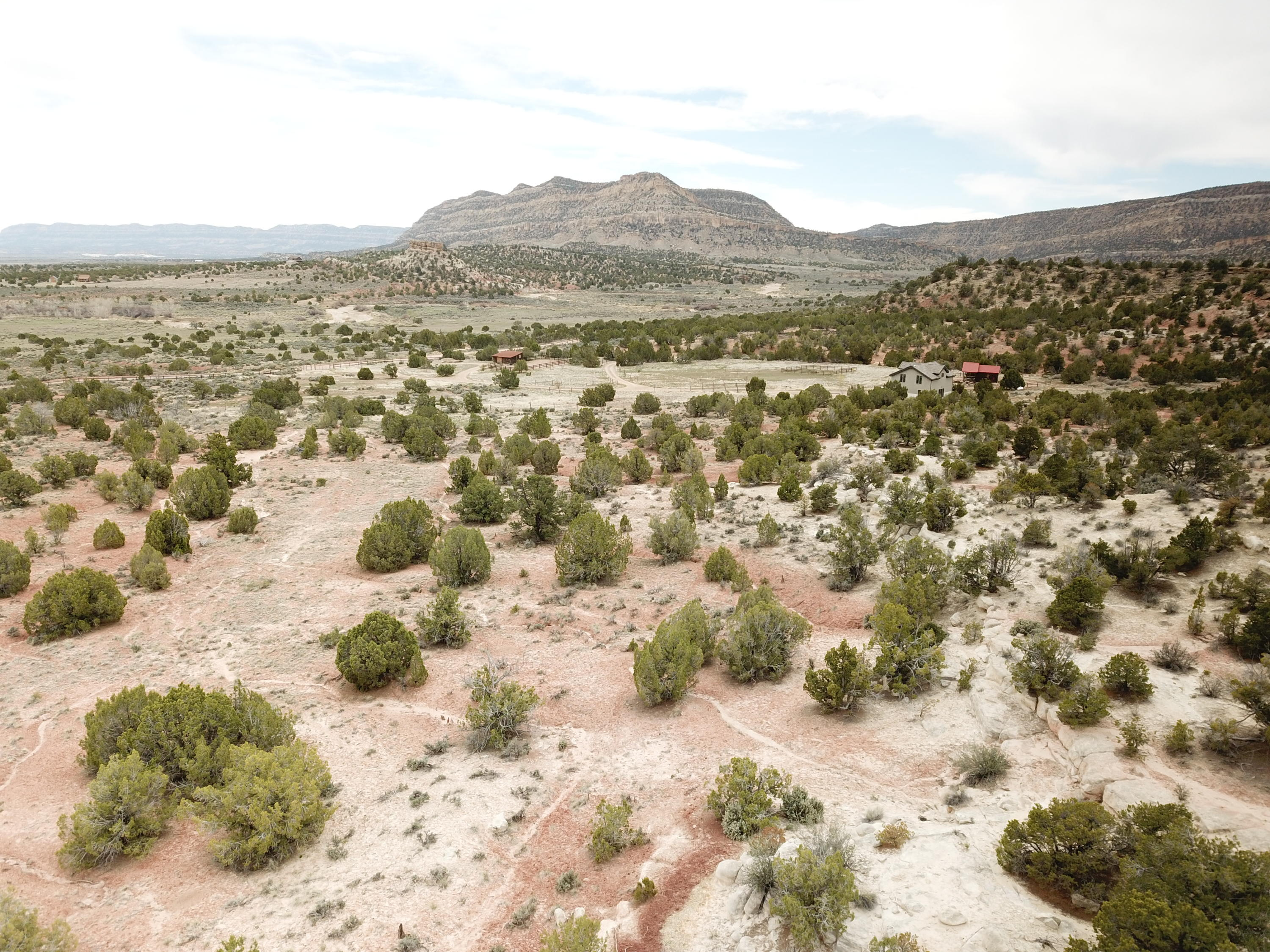 Looking to find a somewhat secluded piece of land, located in the town of Escalante, yet less than 1.5 miles from Main St. - Great 2 + acres located at the base of a hill, with a spectacular sunrise! A perfect piece of land that makes you feel remote, but close to amenities...restaurants, grocery stores and local pub. Easement and road being put in from Smokey Mtn Rd.  Backs to Public Lands!