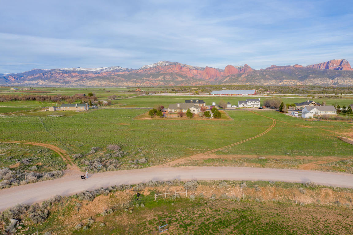 Beautiful 2.5 acre lot in Harmony Heights subdivision. The views are incredible of the Kolob Fingers in Kolob Canyon, a section of Zion National Park. This lot is flat, ready to build and has 360 degree views. Perc Test and septic design have been completed. Easy to build and have beautiful views on this lot. Professional house designs available for 2041 sq ft one level, 3 bed, 2 1/2 bath home.