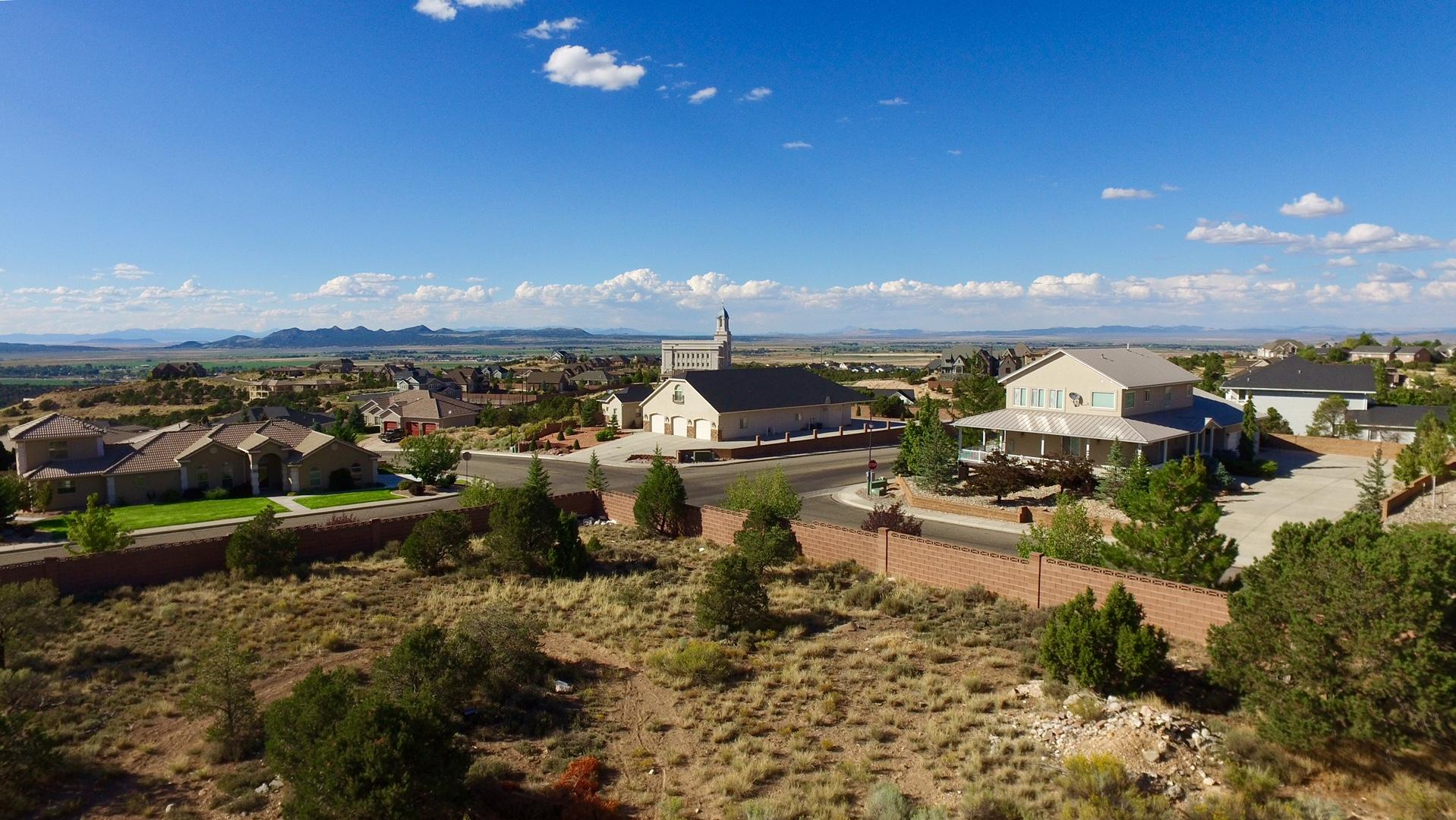 Amazing opportunity to live in an exclusive, gated, million dollar community for minimal cost.  This is a flat lot, is ready to build on and is located blocks from the new Cedar City Temple.  With a two story home you will have a perfect view.  Block walls surrounding the property are also in place (huge cost savings). Build your dream home or a spec home for resale.  Owner/Agent