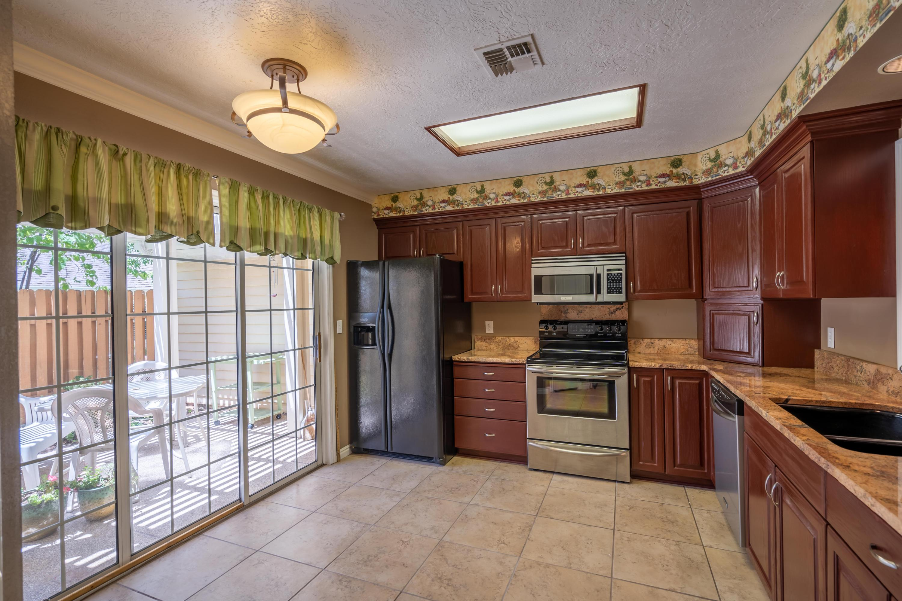 Beautiful 1 level town home located close to everything!  This town home is super clean and full of upgrades.  Private back yard patio and a full two car garage.  This town home has been upgraded with tile floors, granite counter tops, and newer appliances.  Located within walking distance to the community swimming pool.