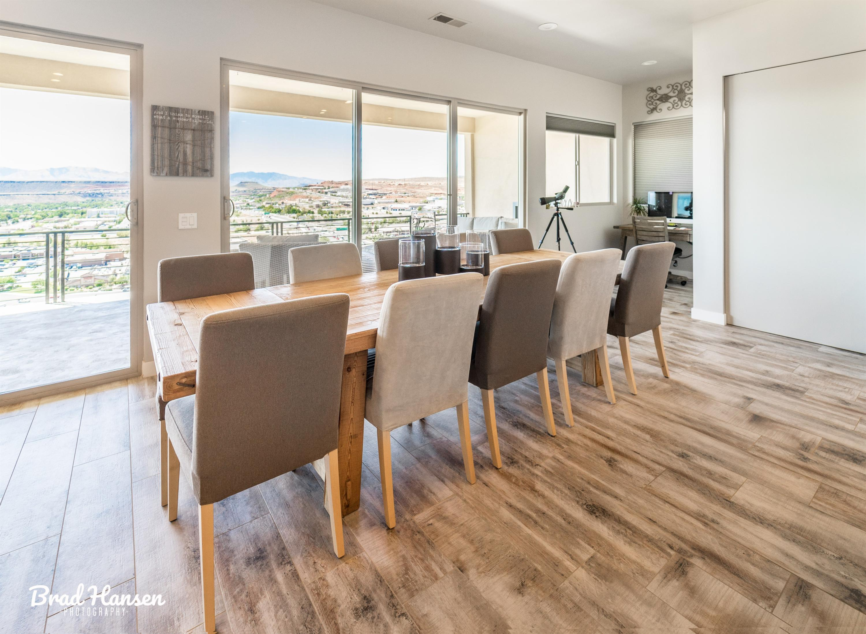 Custom in every way, handicap friendly, contemporary and clean lines. Incredible city and mountain views. No HOA, close to everything. 10 minutes to six Golf Courses, 3 minutes to hospital. Wood tile, huge great room, 3\