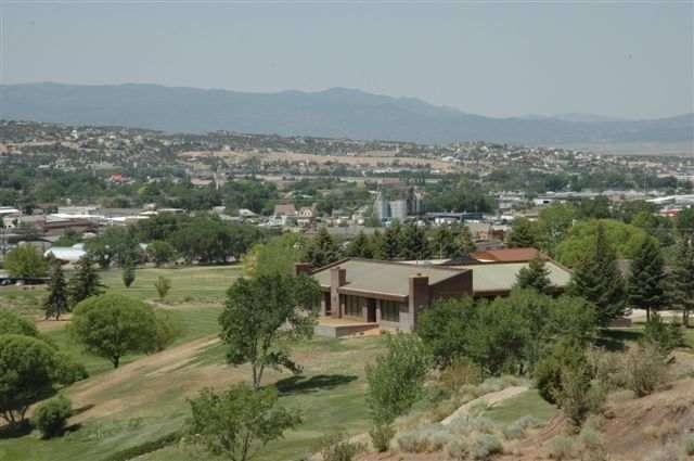 R-3 property, master-planned as Cedar Ridge Townhomes. Located on Cedar City Golf Course holes 1, 3, & 10. 5.35 acres includes prestigious office building and 40 lots for retirement community. Office at top of the hill is perfect clubhouse and rental office with large reception room, 2 public bathrooms, kitchen & dining area. Panoramic views. Three large offices have private deluxe bathrooms