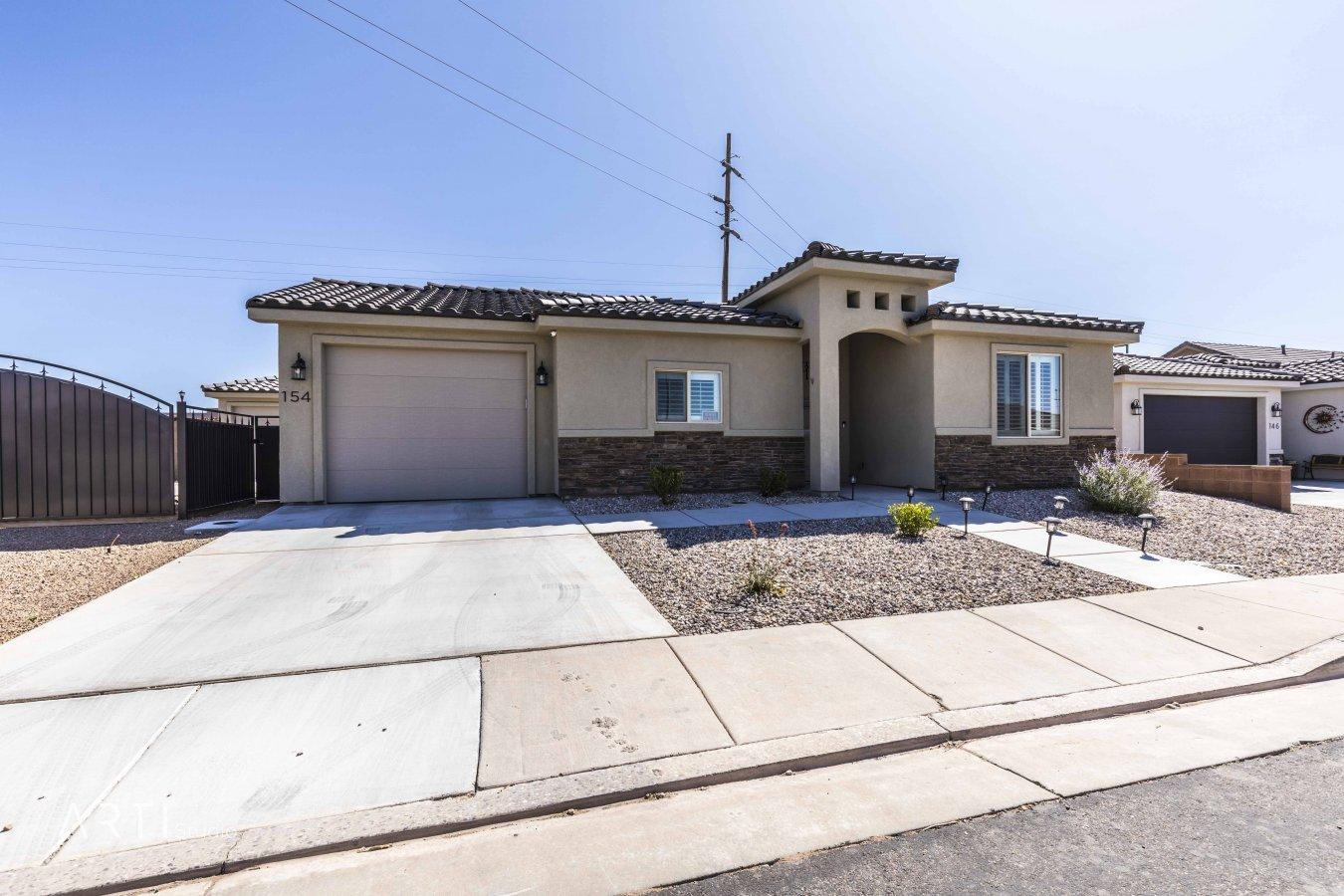 Check out this one of a kind home!  Built in 2018 with both attached and detached garages.  Just 10 minutes away from Sand Hollow Reservoir and easy access to the local dunes.  Fully fenced yard. Square footage and lot size to be verified by buyer.