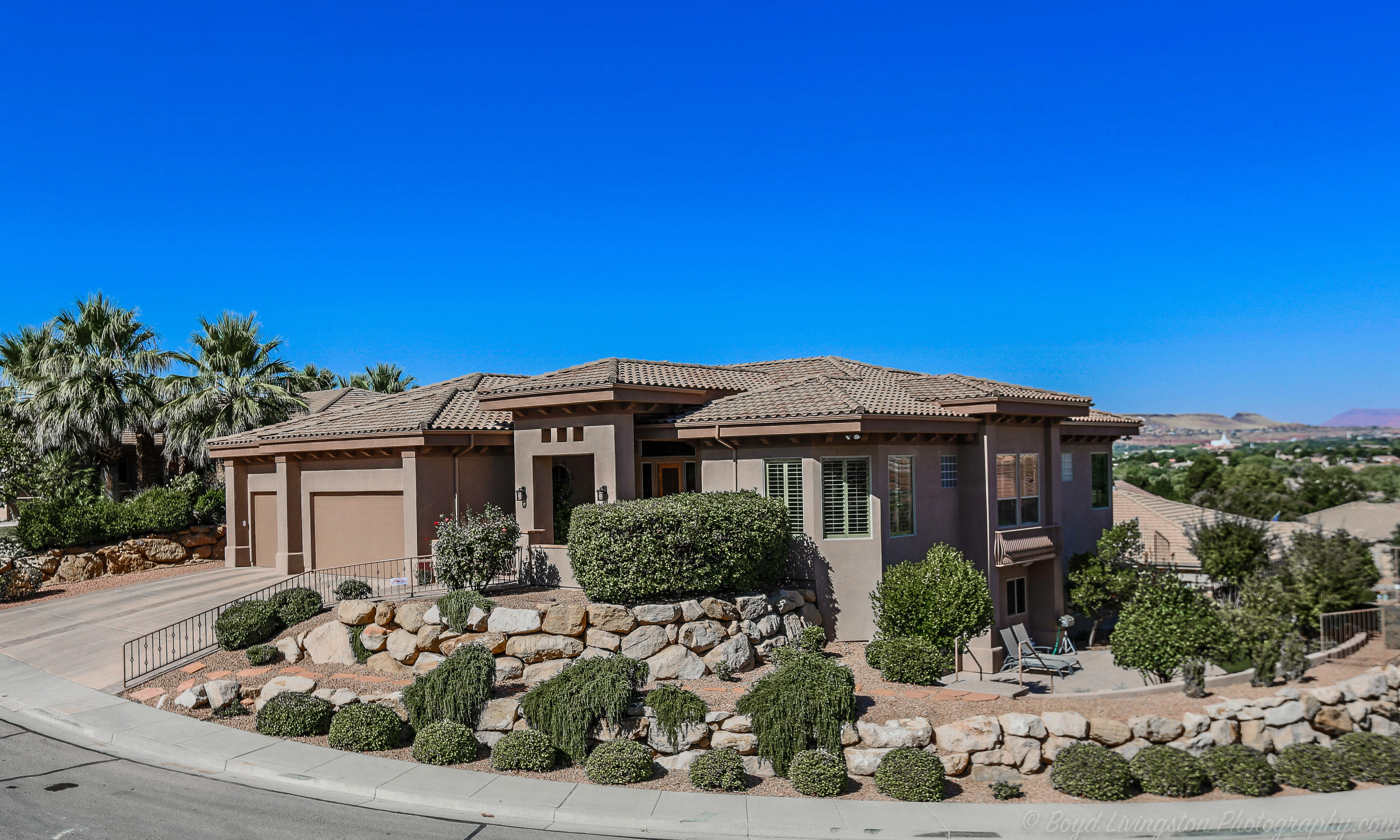 This house has all of the upgrades and character you could dream of. This is a 2003 Parade of Homes . Professional chef grade kitchen and island.  Plus Half Kitchen. Views of Snow Canyon, Pine Valley Mountain, The Red Rocks of Dixie the Temple and City. Updated waterfall and spa. This home sparkles with cleanliness and like new condition. New gutters and fresh exterior paint. Like New Condition