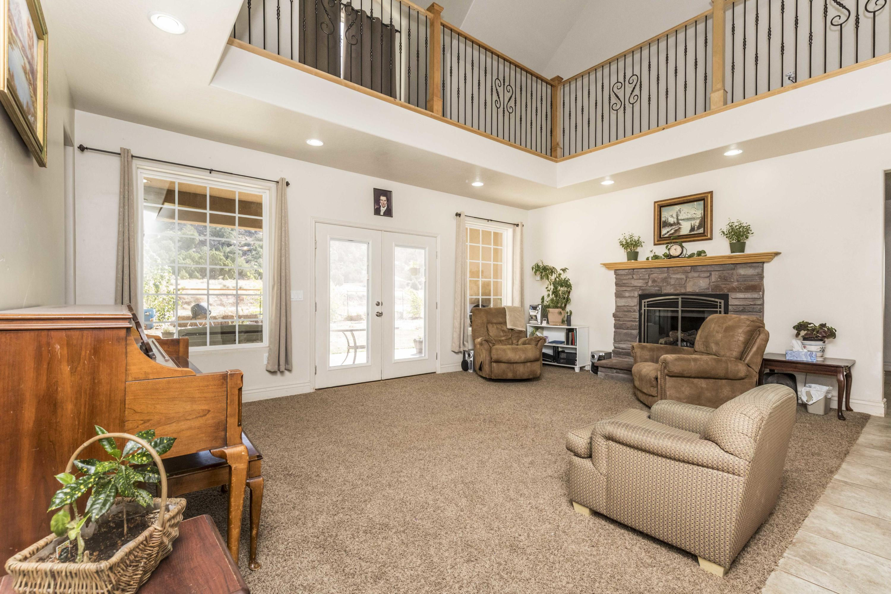 Room for EVERYTHING!  If you were looking for a place with some elbow room, this is the place!  An acre of open space ready for horses, a shop...the possibilities are endless!  24 hours notice to show preferred but not absolutely necessary.  Schedule your showing today!