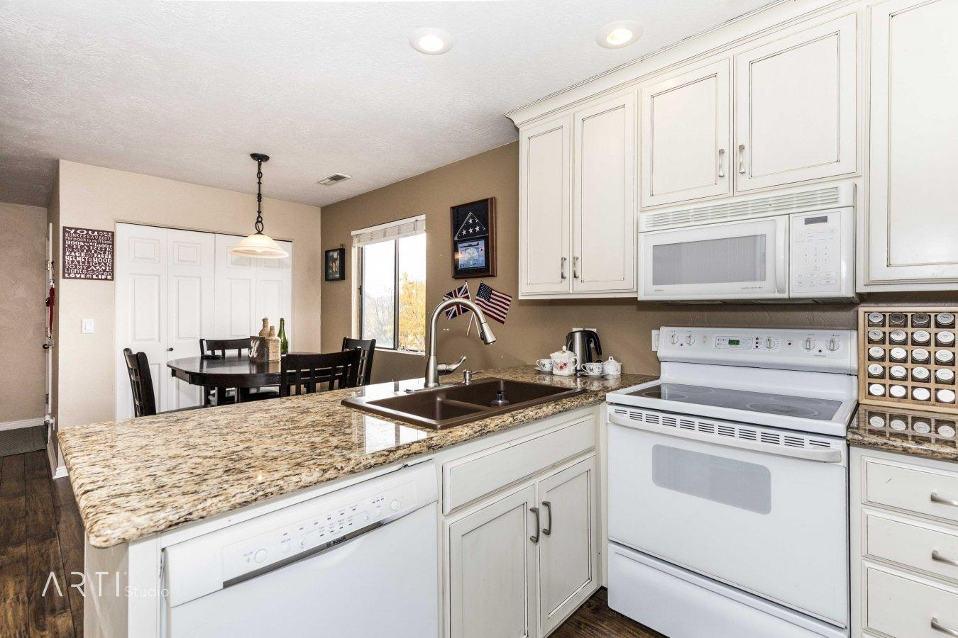Great Location, Very rare find. Darling Condo features custom cabinets in kitchen, wood laminate flooring, custom sliding barn door for back deck access. Views of Pine Valley Mountain.