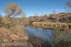 NEARLY FIVE ACRES + CREEK WATER RIGHTS