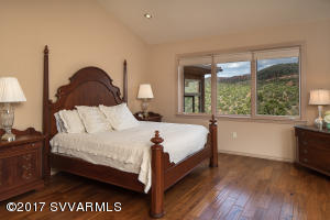 Master Bedroom With Hardwood Flooring