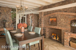 Formal Dining With Cozy Fireplace