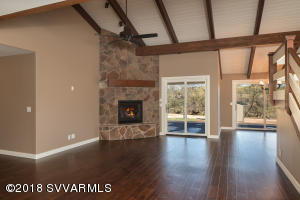 GREAT ROOM WITH MOSS STONE FIREPLACE