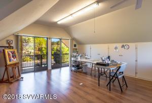 More artist studio with outdoor deck