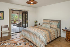 SECOND GUEST BEDROOM WITH SUNSET DECK AC