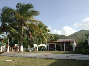 Casa En Venta En Municipio Antolin Del Campo Paraguachi, Playa El Agua, Venezuela, VE RAH: 16-9762