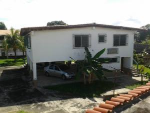 Casa En Venta En Higuerote - Ciudad Balneario Higuerote Código FLEX: 20-1293 No.0