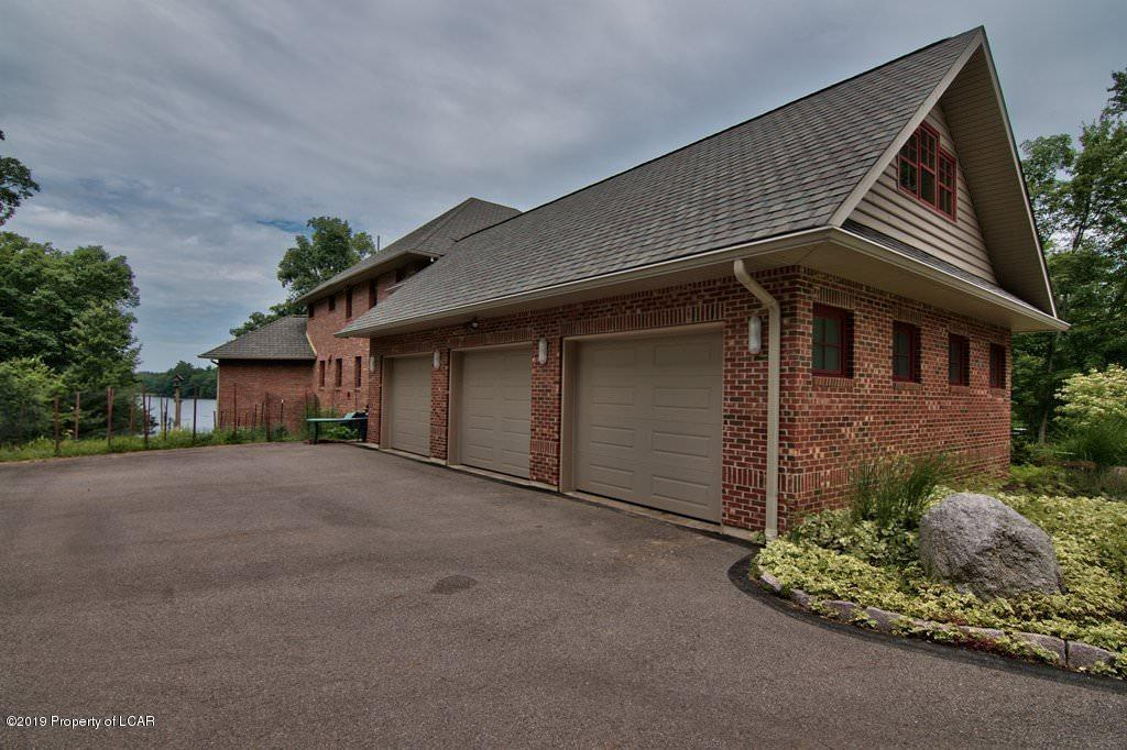 Side View with 3 Car Garage
