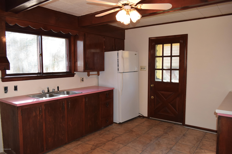Kitchen with ceramic tile flooring