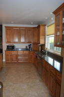 Granite/handcrafted cabinetry