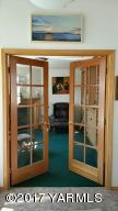 French doors to den off entry