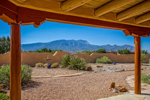Front covered patio with Spacious Fully Walled Courtyard facing Sandia Mountain
