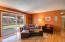 Beautiful red oak hardwood floors carry clean look throughout home.