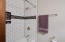 Subway tile shower with custom glass tile niches