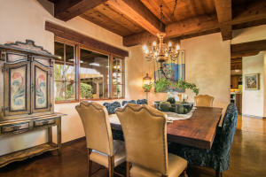 Formal dining with wood beamed ceiling