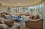 Gracious living room (27 x 17) with east facing wall of windows offering city, mountain, and garden views.
