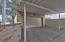 Large 2 car carport and over sized garage.