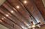 Herringbone patterned wood ceiling with large beams