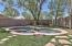 Natural style heated gunite pool with Auto cleaning pop ups