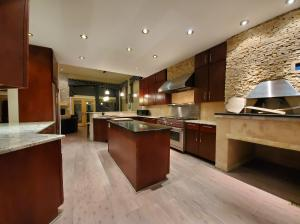 Custom Kitchen with Wolf Cooking System and Pizza Oven