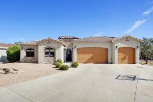 A touch of Tuscany in this gracious custom home nestled in the highly prestigious North Valley