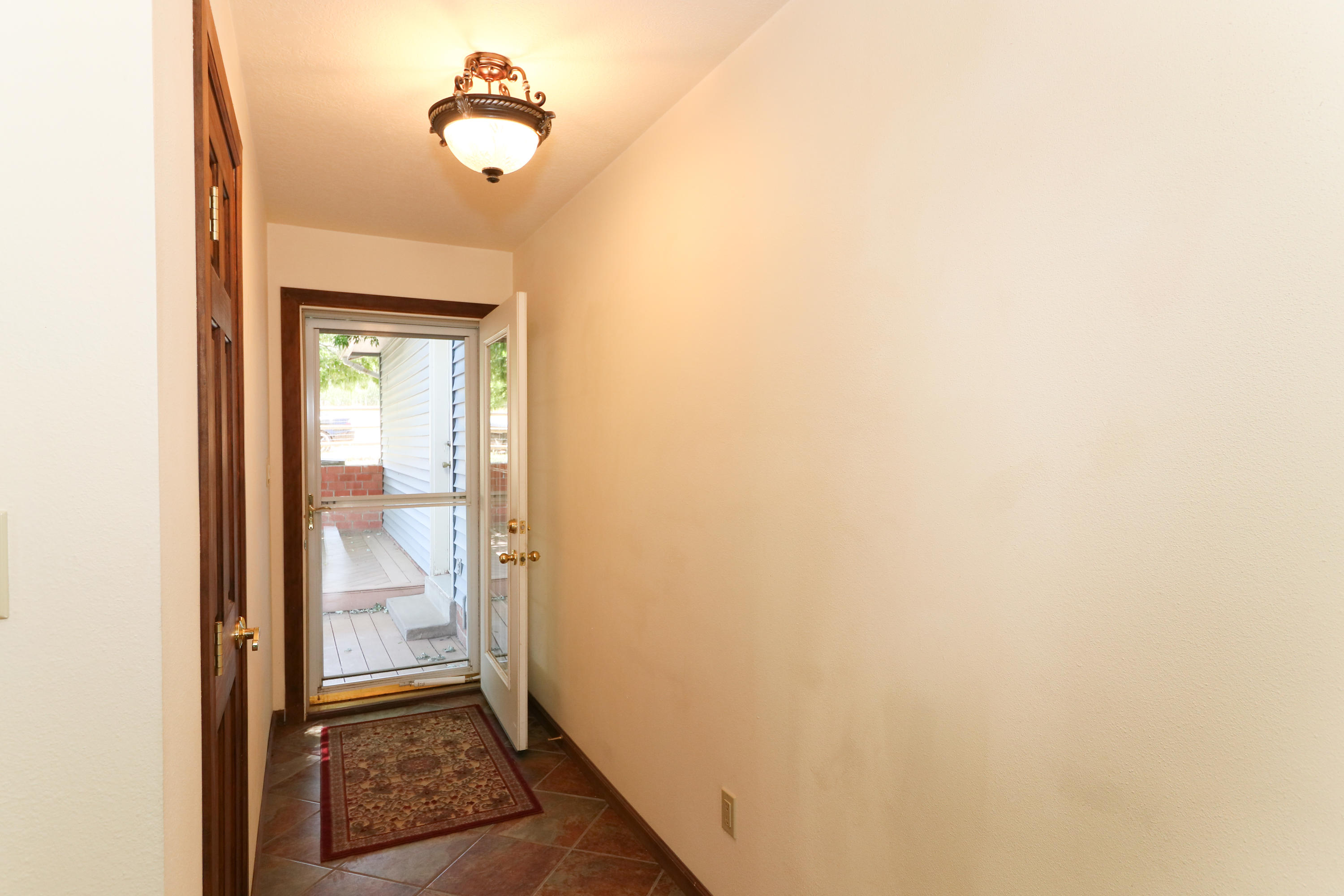 Hallway to patio on side of house