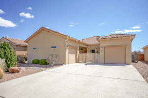Faces west with separate garages and easy care front yard landscaping.